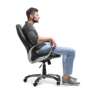 Man sitting in computer chair with poor posture