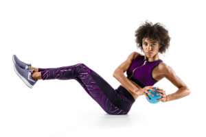 Fit woman doing medicine ball exercises