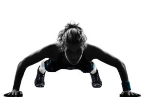 Fit woman in pushup position